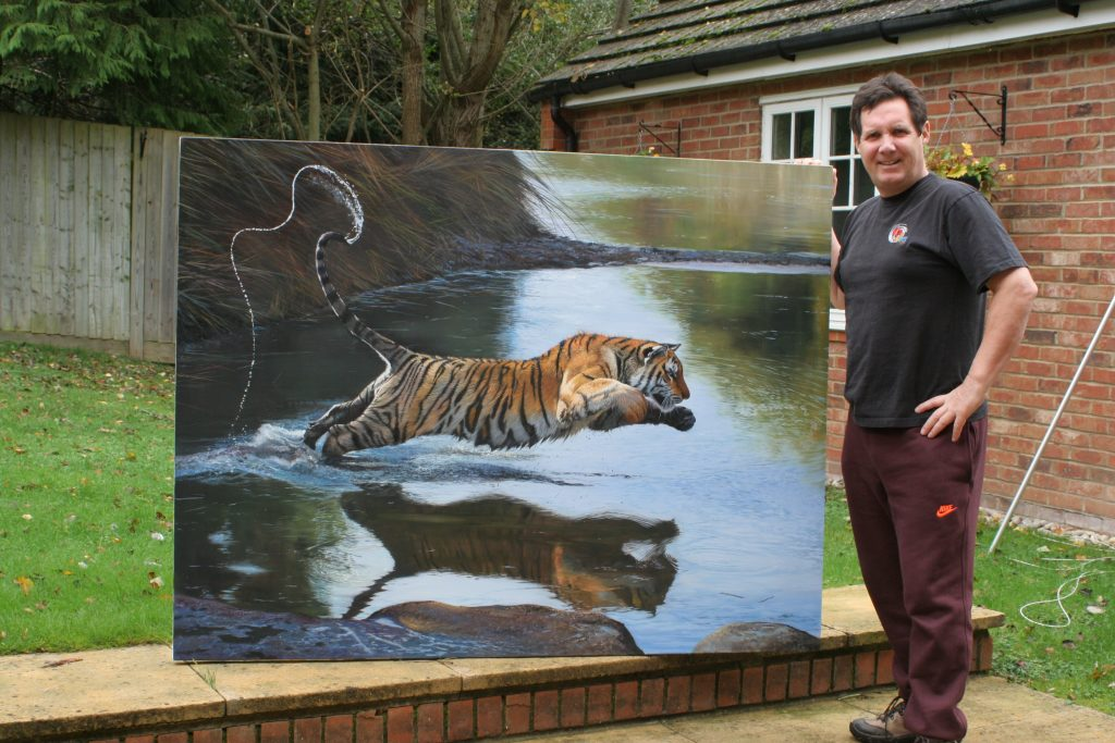 Wildlife Artist Pip McGarry with 'Leap of Faith'. Exhibition coming up at The Frame Gallery in Odiham